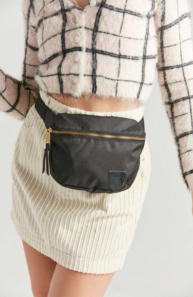 Black leather fanny pack with gold zipper.