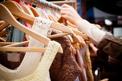 A rack of second-hand women dresses at a market in London: recession bargains.