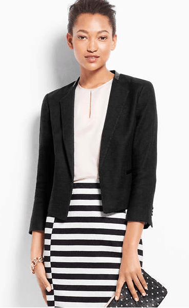 Work outfit consisting of blazer, white top and striped pencil skirt.