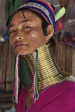 Woman wearing brass neck rings