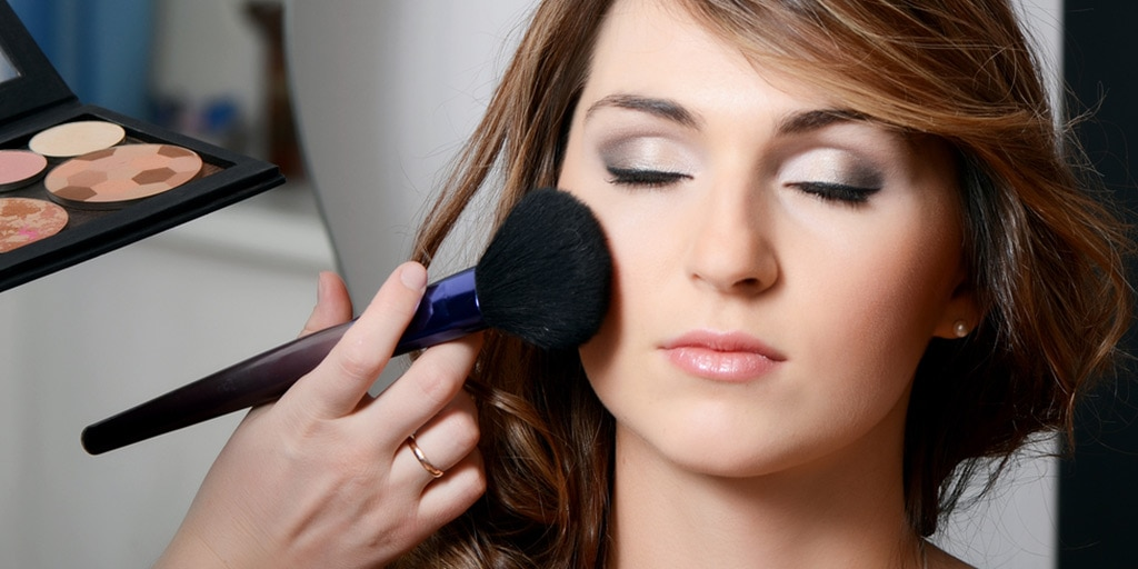Woman getting her makeup done