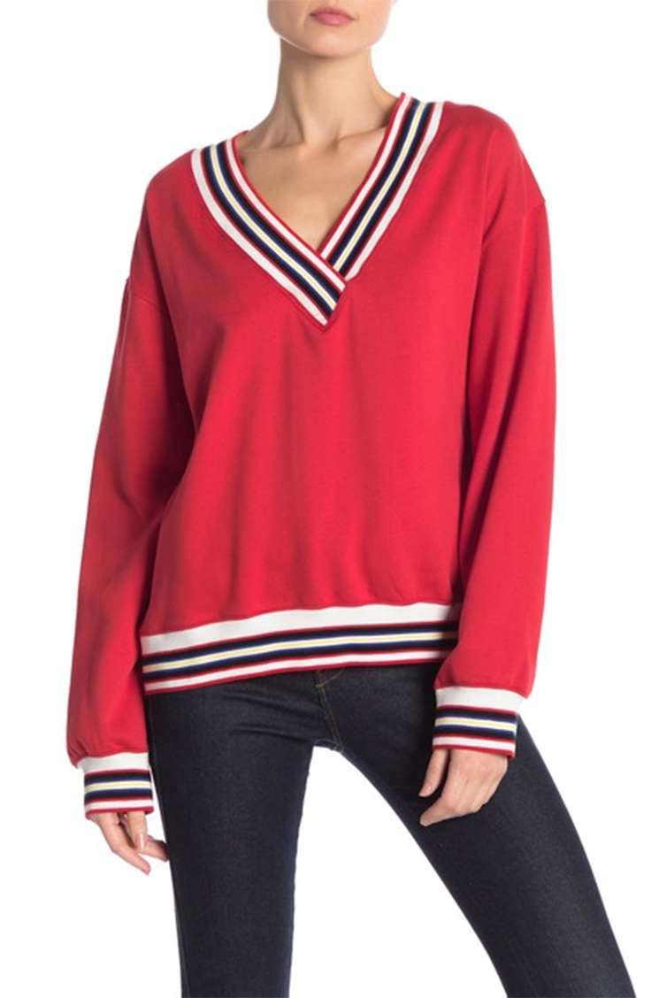 Red sweater with striped details.