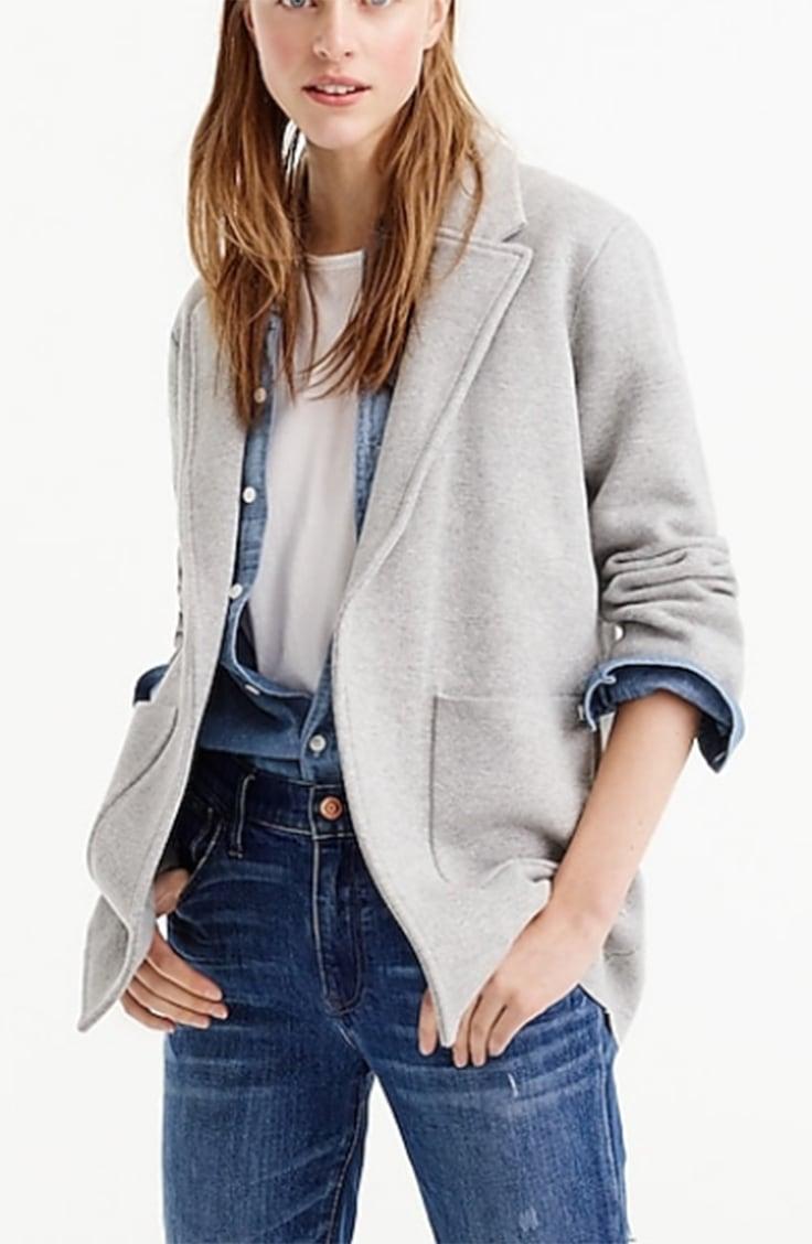 Woman wearing grey, open-front blazer