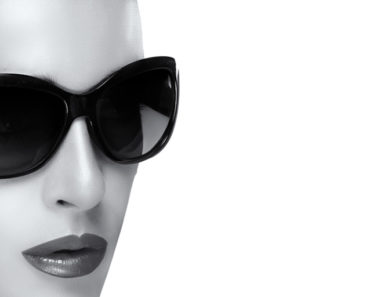 Black and white image of woman wearing large sunglasses