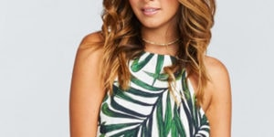 Close up of woman wearing palm print trend dress