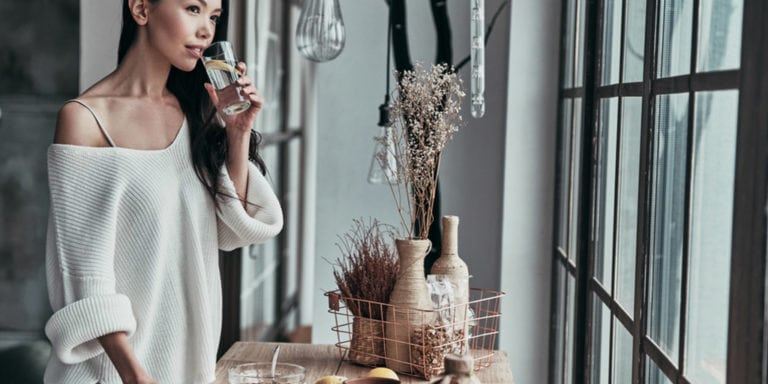 Stylish woman in well-decorated home