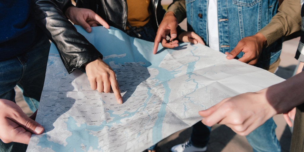 Group of travelers looking at a map