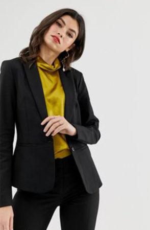 Woman wearing black equestrian inspired blazer