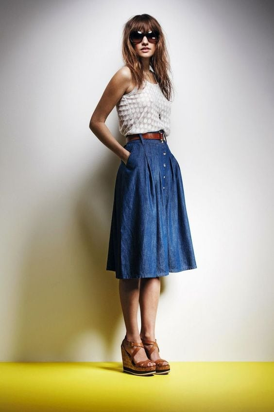 Woman wearing long a-line denim skirt with tank top and wedges