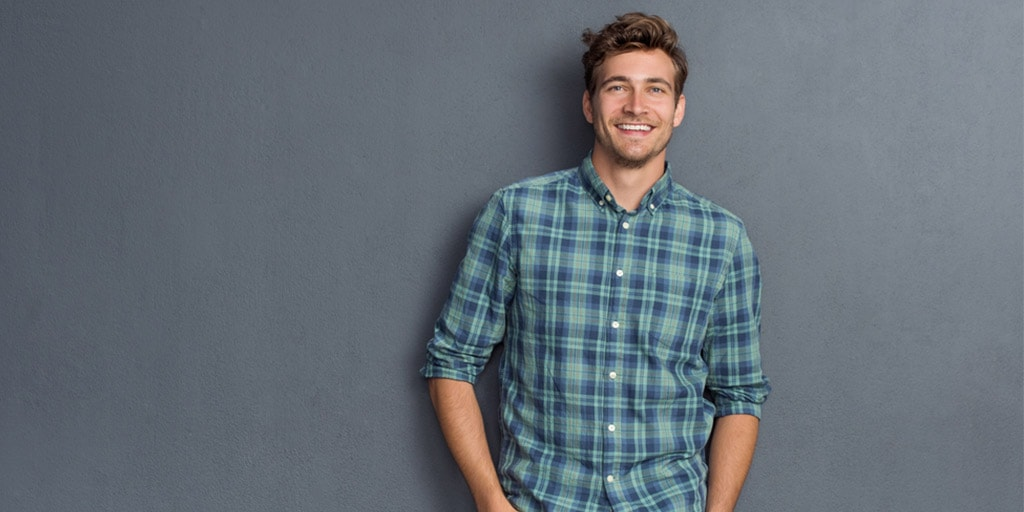 Smiling man wearing plaid shirt