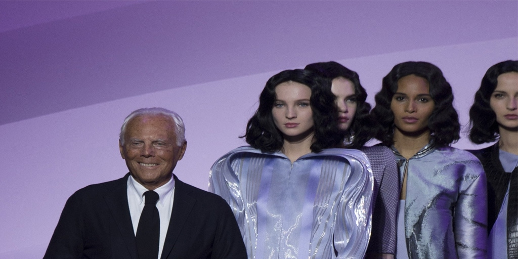 Fashion designer and models on the runway