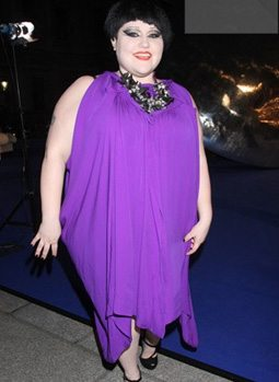 Beth Ditto wearing purple dress