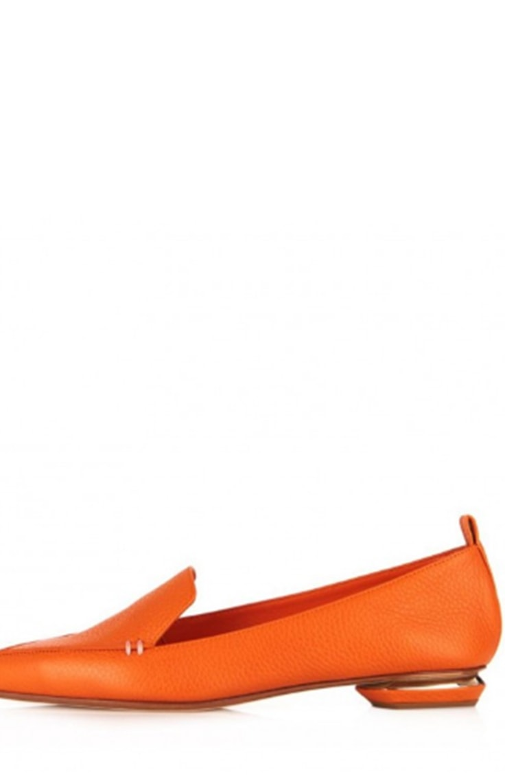 Orange slip on shoe with interesting heel design