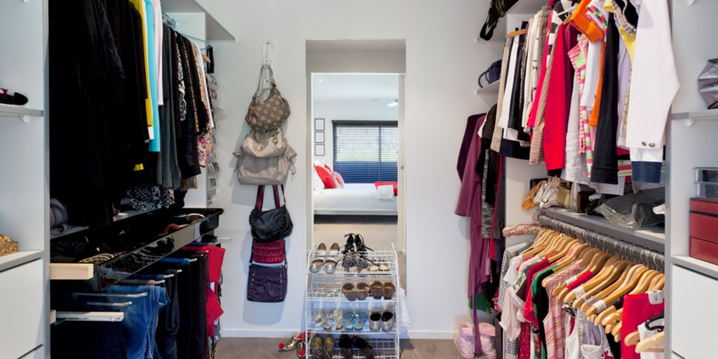 Organized closet with women's clothes