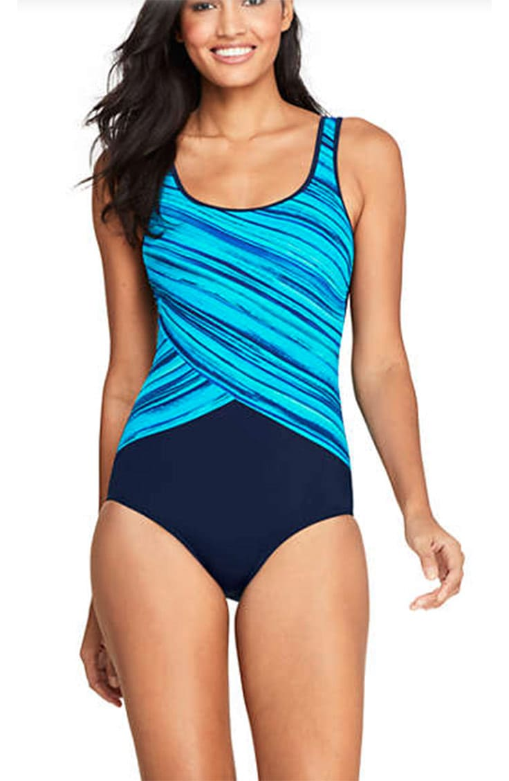 Tall woman wearing one-piece swimsuit with patterned top