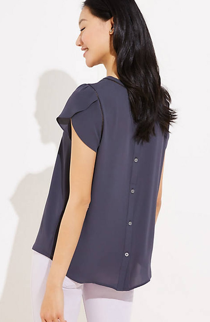Navy blue button-back top with jeans