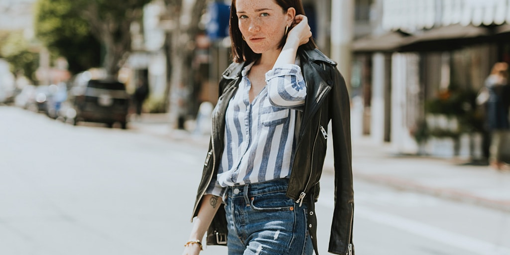 Woman wearing striped shirt with jeans