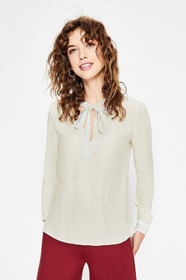 Tie neck blouse in cream