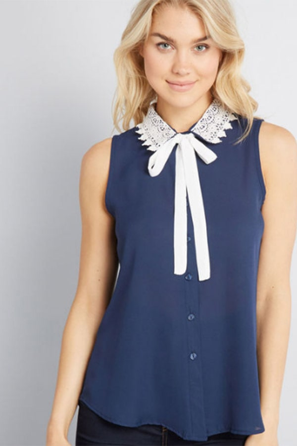 Blue and cream tie-neck blouse