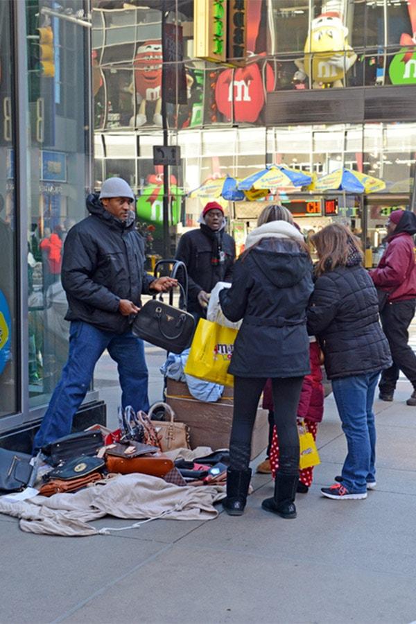 Women buying fake bags in Manhattan