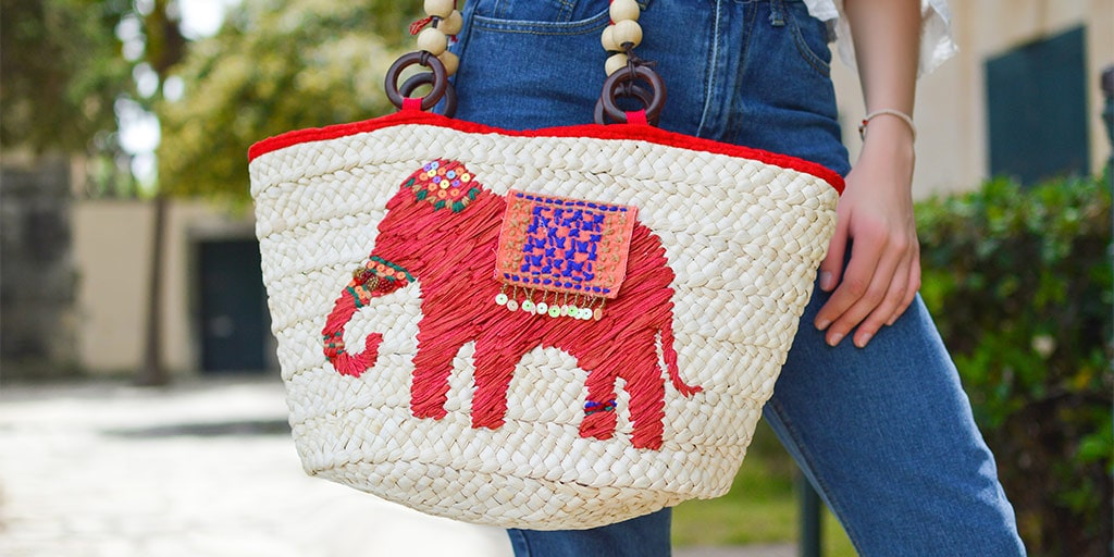Colorful handbag featuring elephant pattern