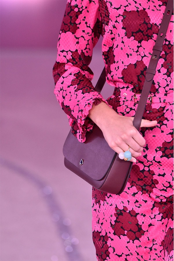 Kate Spade model on runway with bag and floral dress