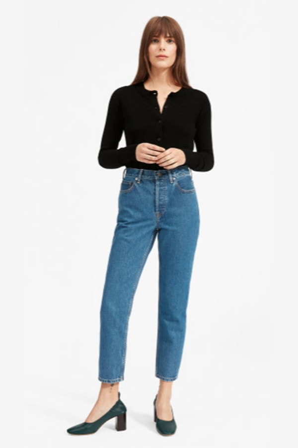 Woman wearing sleek top and mom jeans