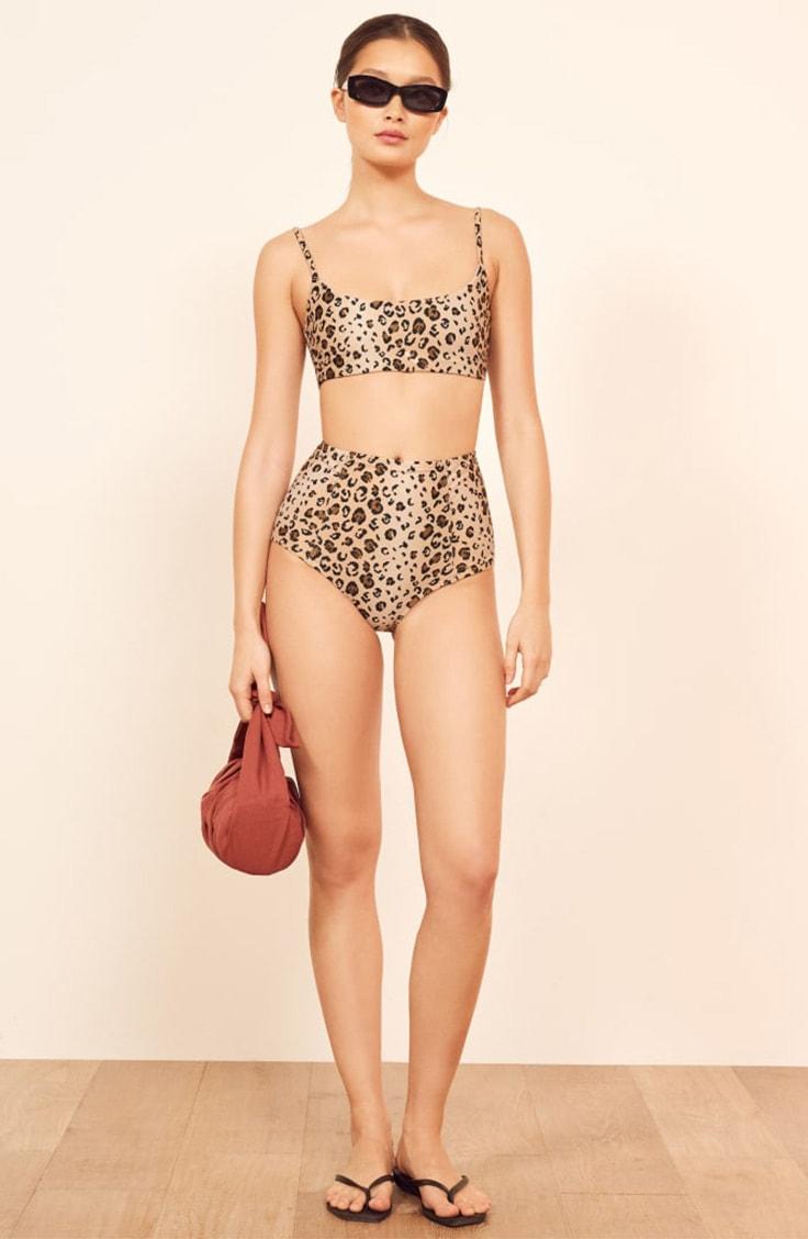 Woman wearing animal print, two-piece swimsuit