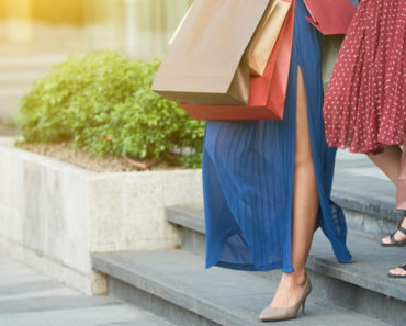 Two women shopping and wearing skirts