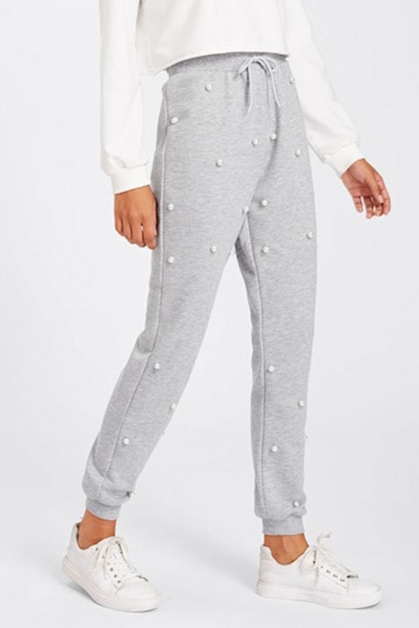 Women's fitness wear: gray sweatpants with pearl embellishments