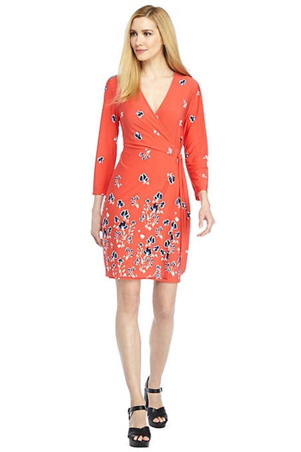 Woman wearing long sleeved orange dress