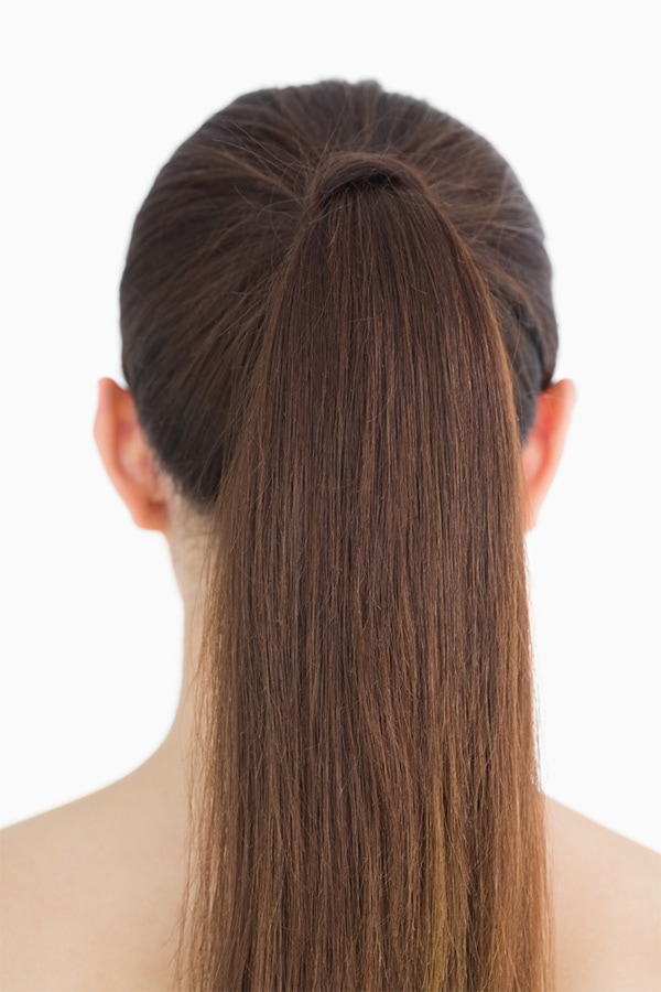 Woman with hair pulled back