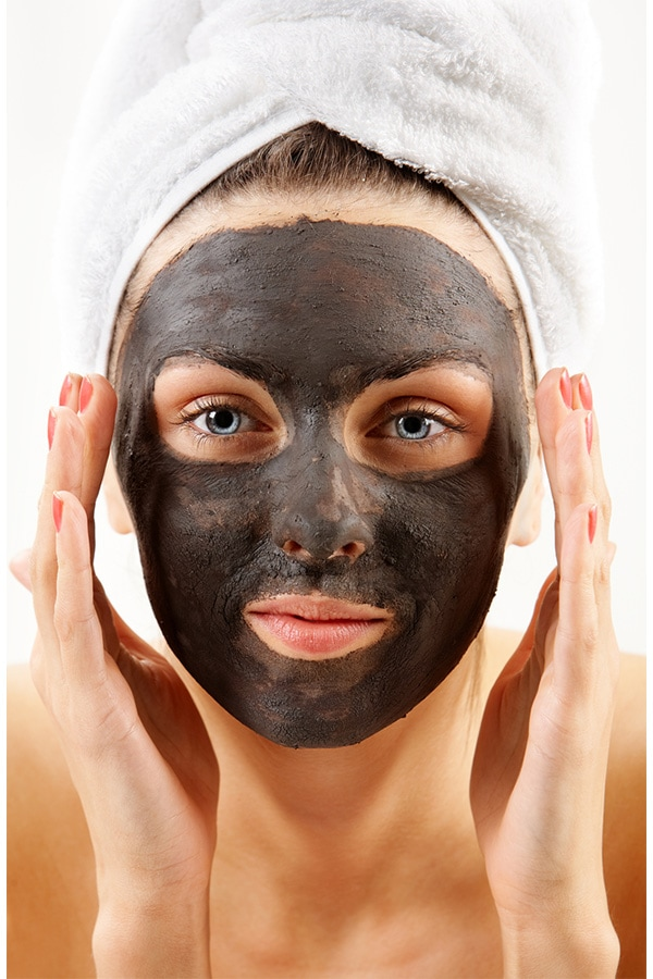 Woman with purifying facial mask