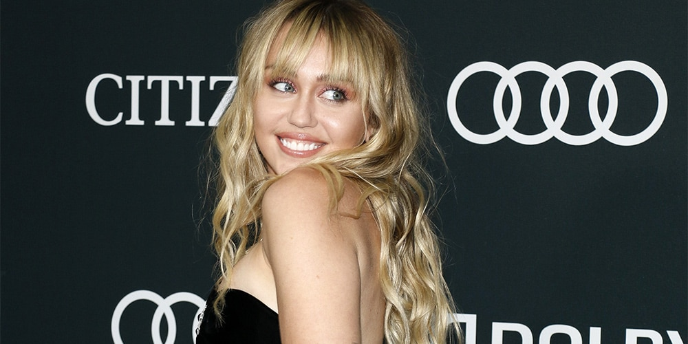 Miley Cyrus with bangs and long hair