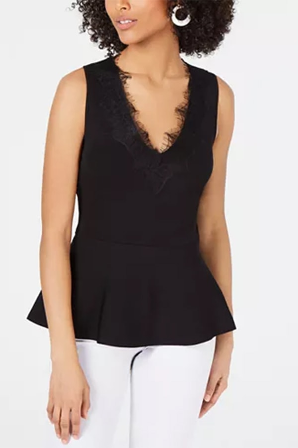 Black peplum top with lace detail at neck