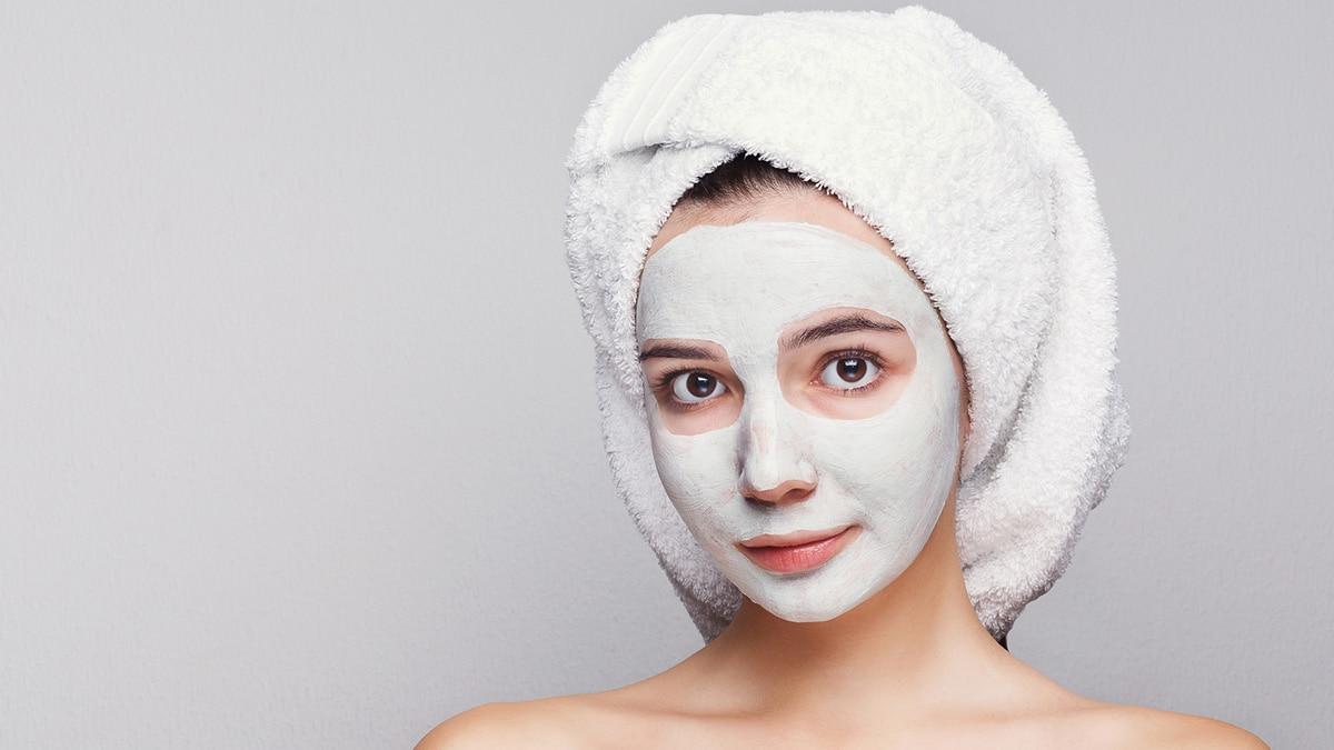 Woman giving herself DIY facial
