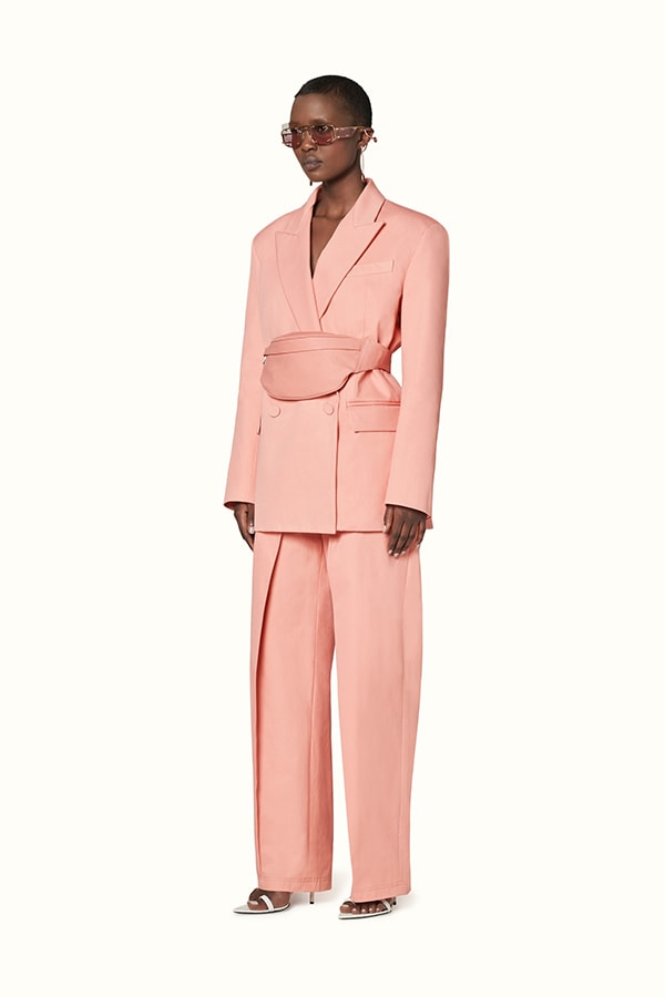 Pink pleated pants by Rihanna's Fenty