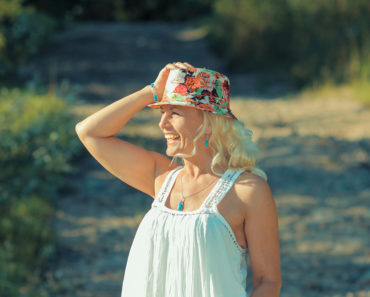 Older woman wearing quirky hat and sundressOlder woman wearing quirky hat and sundress