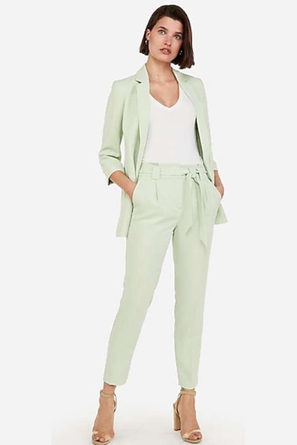 Woman wearing mint green suit from Express