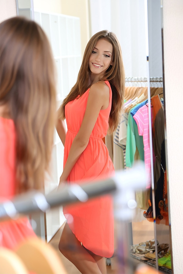 Woman trying on a dress in the dressing room