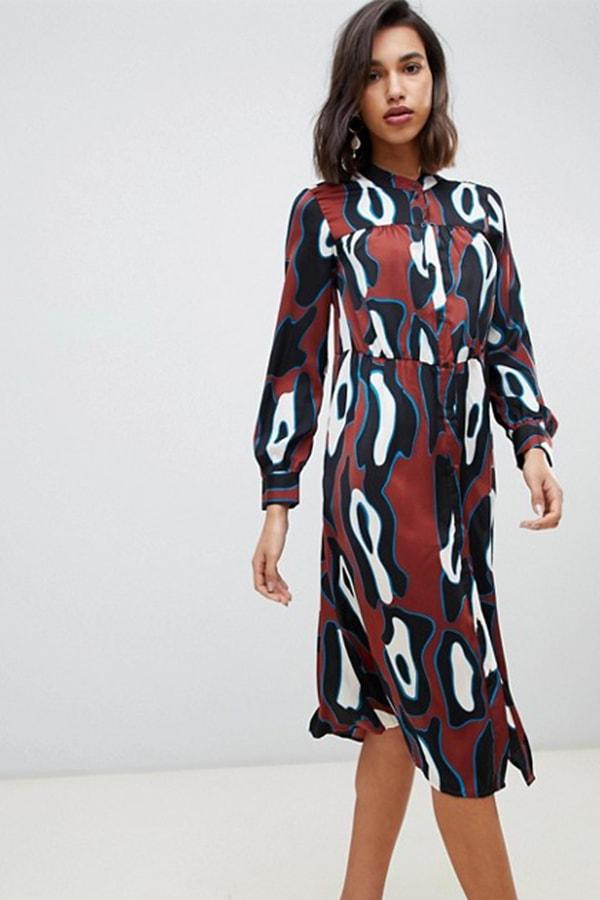 Woman wearing abstract print dress