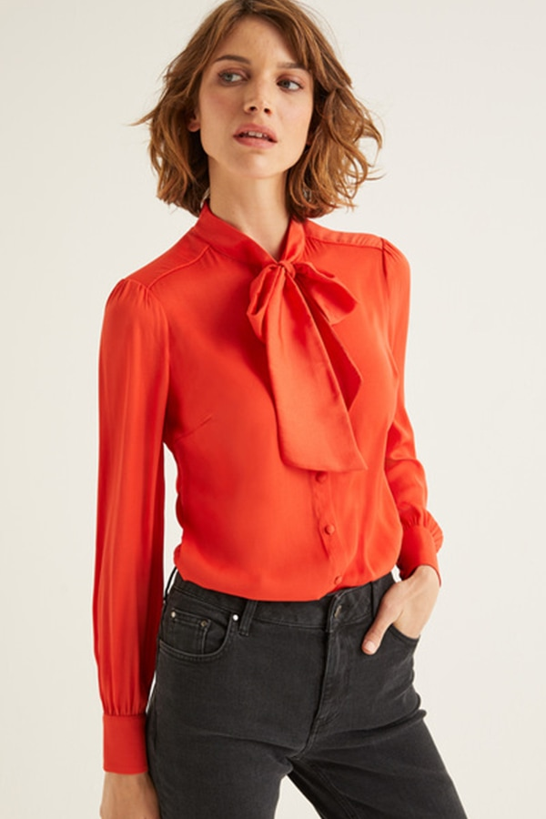 Orange-red blouse with bow