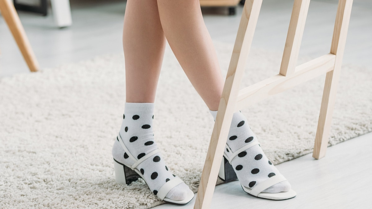 Woman wearing polka dot socks with sandals