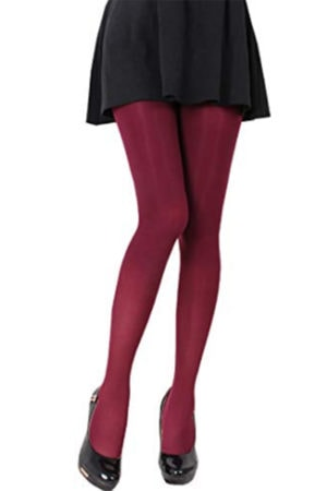 Woman wearing maroon tights and black skirt with black shoes