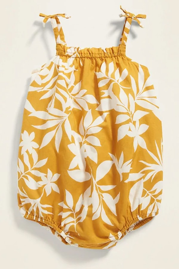 Yellow onesie with patterned print