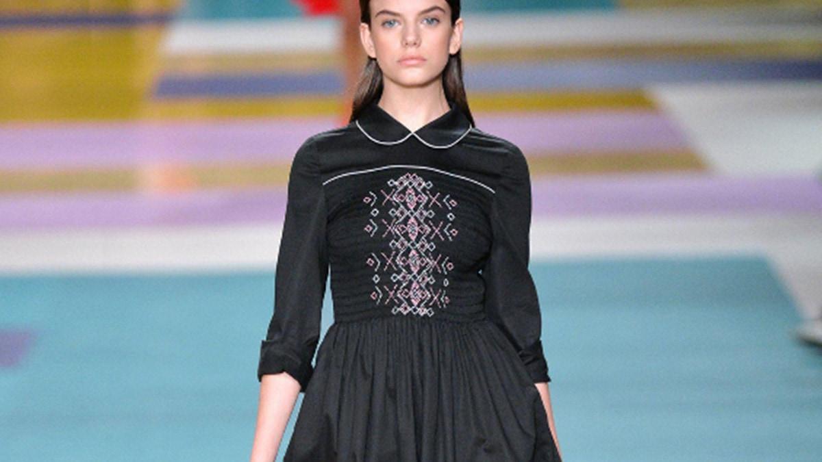 Fashion model on runway wearing smocked dress