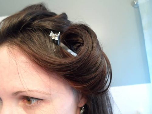 Woman with clips in curled hair