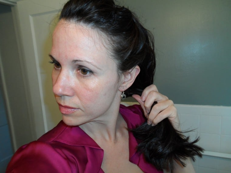 Step 5 of updo tutorial: pull hair to the side.