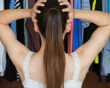 Woman staring at cluttered closet