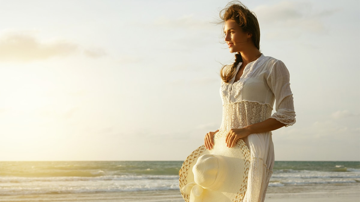 Woman wearing cotton outfit on the beach